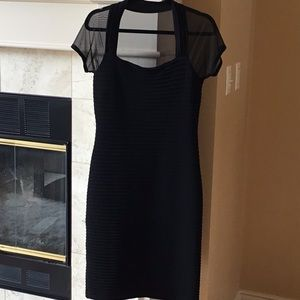 Black cocktail dress with shear back and sleeves